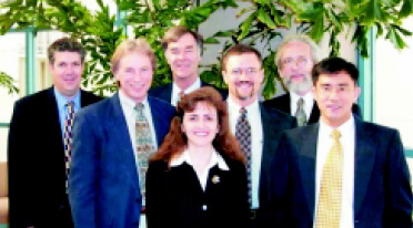 Fig. 2—Texas A&M's Project Bright Star Team led the presentation and negotiations with SureBeam. Shown from left are Lee Deviney, Assistant Commissioner, Finance & Agribusiness Development; Mark McLellan, Director and Professor, Institute of Food Science and Engineering; Alan Waltar, Professor and Department Head, Nuclear Engineering; Elsa Murano, Associate Professor of Animal Science and Director of the Center of Food Safety; Dale Whittaker, Professor and Associate Head of Agricultural Engineering; Leslie Braby, Research Professor of Nuclear Engineering; and Rudolfo Nayaga, Associate Professor of Agricultural Economics