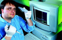 A USDA geneticist prepares to load PCR samples onto an automated DNA sequencer.