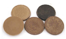 Stages of normal (fat) bloom on chocolate discs stored incorrectly or for long periods.