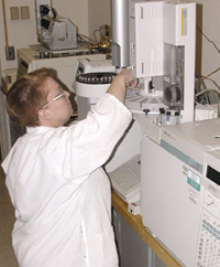 Medallion Laboratories Chemist Heather Newcomb conducts a gas chromatographic fat analysis by AOAC Method 996.06.