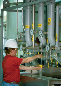 Plant employee samples production of 200-proof ethanol.