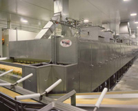 Multistage conveyor dryer, shown here processing French fries for the fast-food industry, provides uniform air velocity and temperature distribution throughout the dryer.