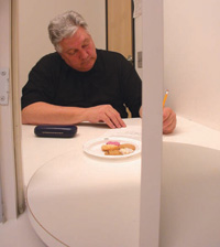 A tester in an isolation booth as seen through the hatch from the serving galley at a Peryam & Kroll Research facility. The serving tray revolves to provide privacy for the tester while the next sample is prepared by the analyst.