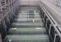 Aerobic treatment system, the Membrane Biological Reactor from ADI Systems Inc., is based on the Kubota flat-membrane concept. Photo shows the membrane basin during clean water testing.