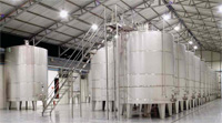Used stainless steel tanks can each hold up to 10,000 gal of food-grade materials