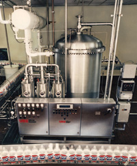 Beverage system consists of a water pre-cooling/deaeration tank, proportioner, and cooler/carbonator and is used in processing carbonated beverages that are cold-filled.