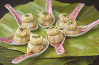 Flavors traditionally associated with beverages are splashing over their boundaries into food products. These flavors can help provide novelty and culinary excitement. Shown here, for example, are Asian-inspired dumplings served with a tea dipping sauce.