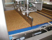 A bank of Branson Ultrasonics horns slicing granola.