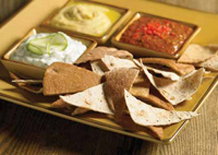 Not too long ago, potato chips and French onion dip prevailed. But today, a wide range of snacking options are available, including this pairing of whole-grain chips with an exotic Mediterranean dip.