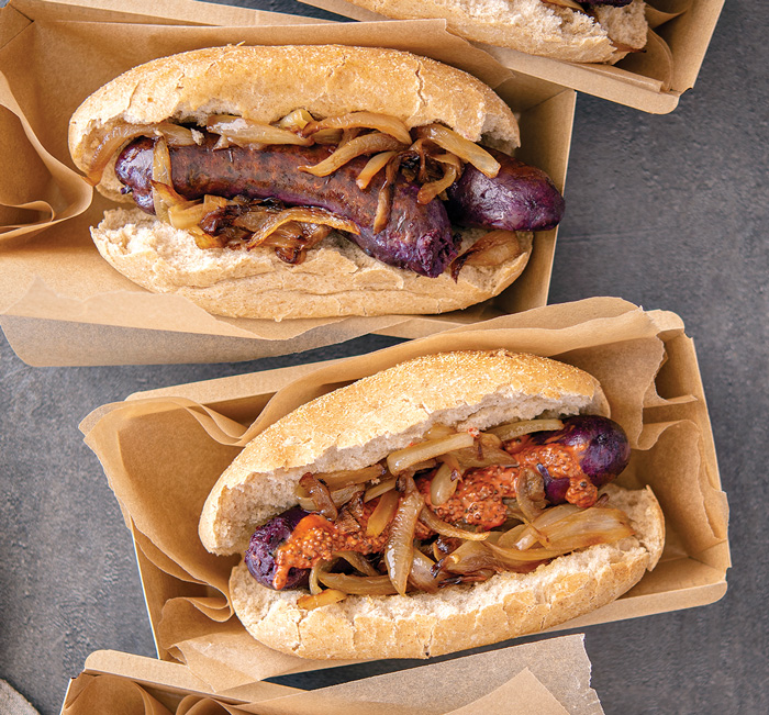 Plant-based, purple-hued sausages feature carrot mustard. Photo courtesy of GNT