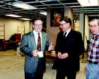 Weber discusses remodeling progress with 1987–91 IFT Executive Director Howard W. Mattson (center) and Director of Publications John B. Klis during the expansion of IFT's headquarters office at 221 N. LaSalle St. in Chicago in March 1992.