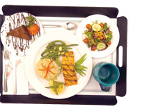 Patients can order enticing meals (top photo) from a hotel-style room service menu at Memorial Sloan-Kettering Cancer Center in Manhattan. The standard hospital tray (bottom photo) is not quite so alluring.