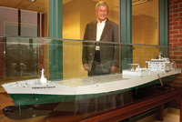 Philip Nelson looks at an 8-ft-long model of the Premium do Brasil cargo ship, a gift from Citrosuco, a Brazilian company that utilizes Nelson's aseptic bulk storage technology. The actual ship delivers orange juice from Brazil to the U.S. in 16 bulk aseptic storage tanks with an overall capacity of nearly 8 million gal.