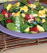 From the Volumetrics Eating Plan, fresh fruit and spinach salad with orange-poppy seed dressing has 150 calories, 30 g carb, 2 g fat, 4 g protein, 8 g fiber, and low energy density of 0.64.