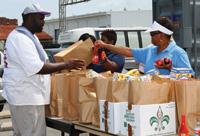 IFT Cares volunteers distribute food and provide support to needy families.