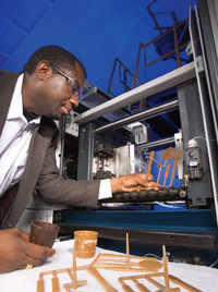 The demand for agricultural products for nontraditional uses such as bioenergy or bio-based materials can potentially change agricultural production patterns, food availability, and food prices. Food Technologist Charles Onwulata uses an injection molder to modify whey protein structures for food and nonfood product development.
