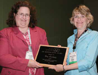 Michele Perchonok (right) presents the Riester-Davis award to Kay Cooksey (left).