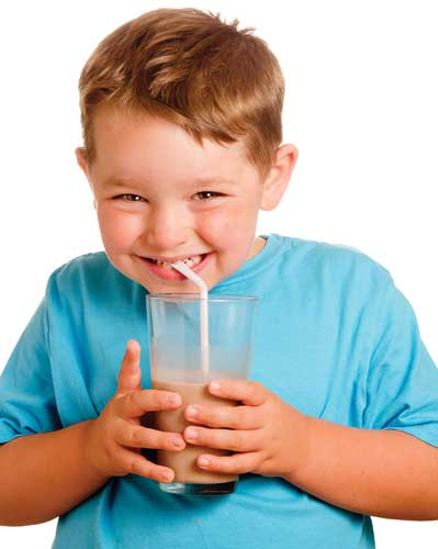 boy drinking chocolate beverage