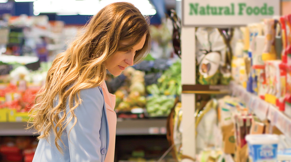 Woman in grocery store natural foods area