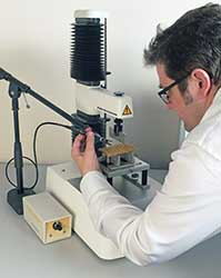 A researcher records force and sound simultaneously.