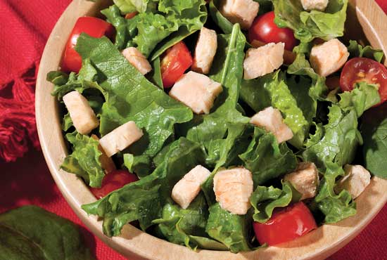Salad with salmon cubes.