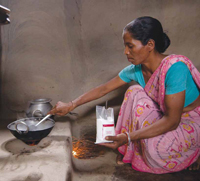 Woman in India cooking a meal with salt fortified with iodine and iron.
