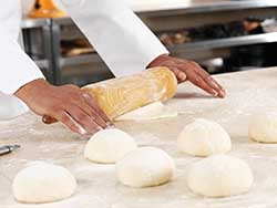 Gluten affects dough structure by making it elastic and extensible.