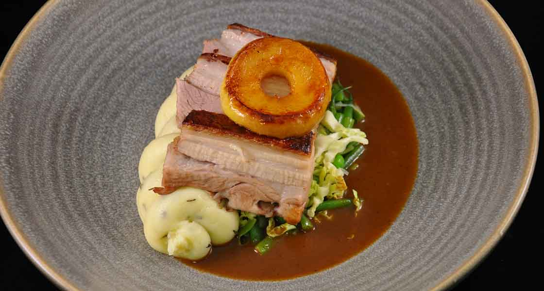 Cider-braised pork belly, buttered cabbage and thyme mash