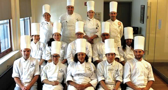 Syrena Johnson (middle row, right) graduates from the International Culinary Center
